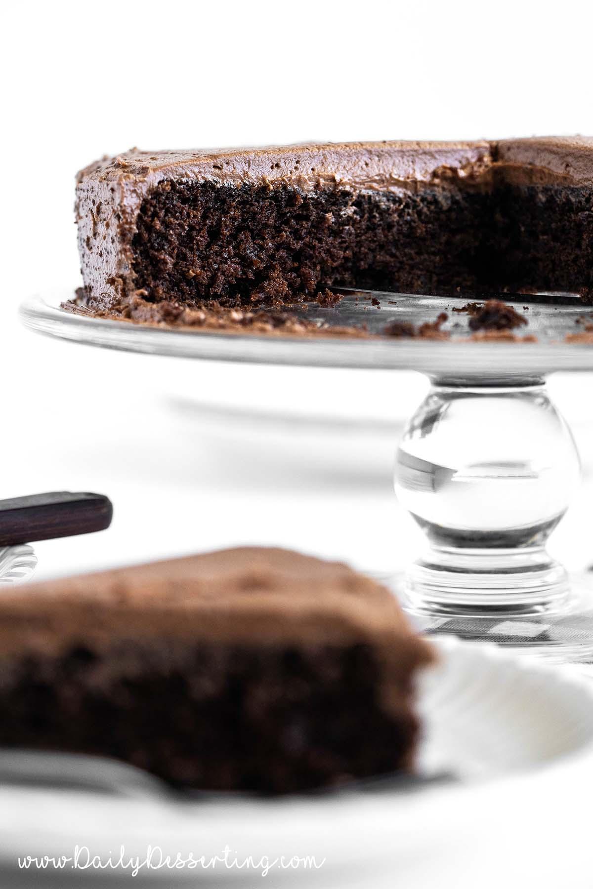 mayo cake on glass cake stand