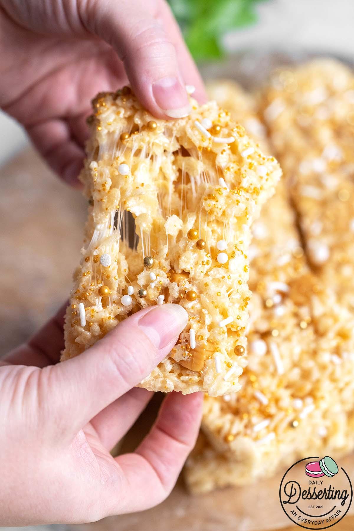pulling gooey rice krispies treat